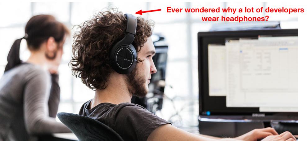 Developer workplace wearing headphone